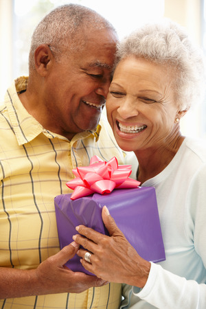 giftwrapped: Senior man giving gift to wife
