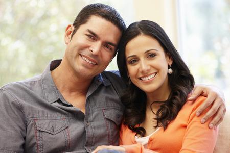 hispanic male: Hispanic couple at home Stock Photo