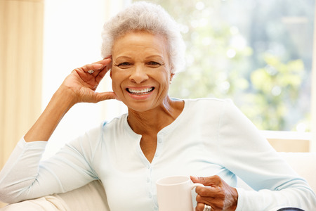 attractive couch: Senior African American woman at home Stock Photo