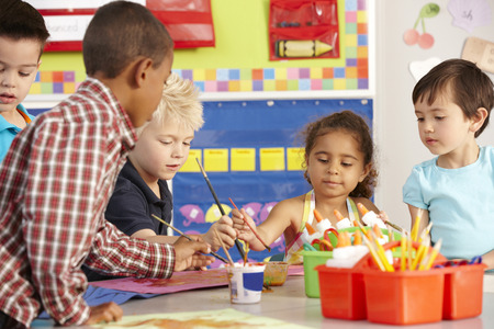children art: Group Of Elementary Age Schoolchildren In Art Class Stock Photo