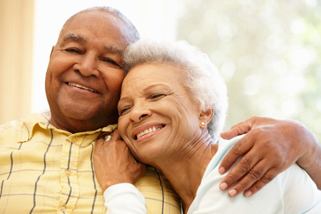 couple on couch: Senior African American couple at home Stock Photo