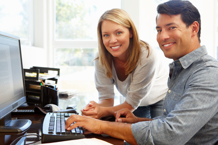 banking document: Couple working in home office Stock Photo