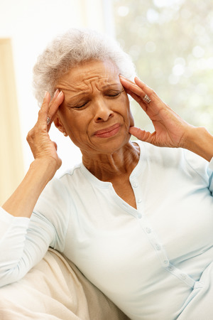 senior african: Senior African American woman with headache