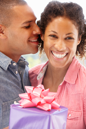 giftwrapped: Man giving gift to woman