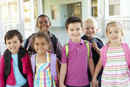 elementary age: Group Of Elementary Age Schoolchildren Standing Outside Stock Photo