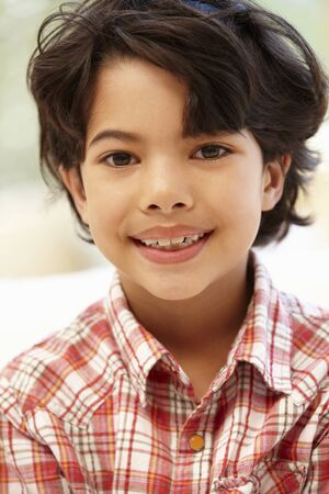 7 year old boys: Young Hispanic boy portrait Stock Photo