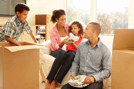 mixed family: Mixed race family in new home