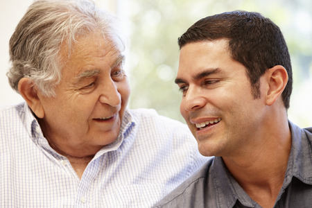 adult 80s: Hispanic father and adult son Stock Photo