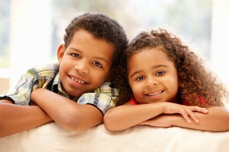 mixed race: Mixed race girl and boy at home