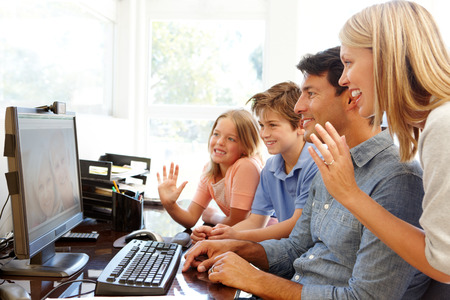 skype: Family using skype in home office Stock Photo