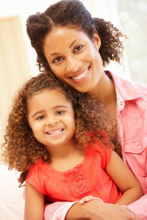 mixed race: Mixed race woman and daughter at home