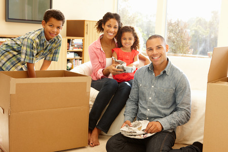 unpacking: Mixed race family in new home