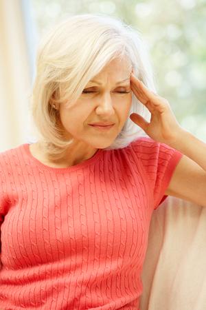 woman headache: Mid age woman with headache
