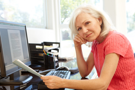 concerned: Woman working in home office Stock Photo
