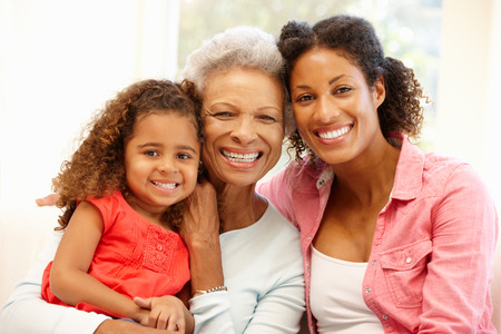 a year older: Mother,daughter and granddaughter Stock Photo