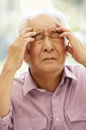 tumour: Senior Asian man with headache