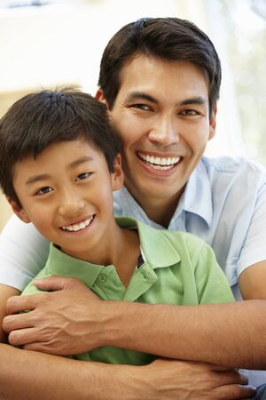 asian guy: Asian father and son