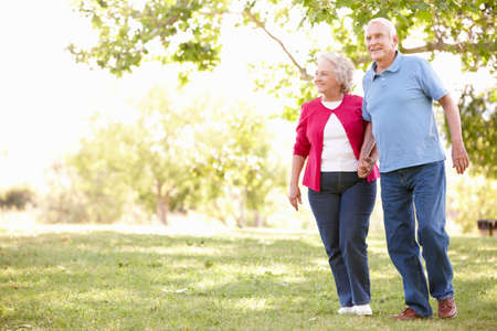 walking: Senior couple in park Stock Photo