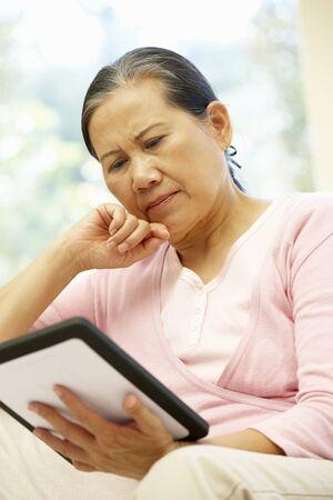 senior women: Senior Asian woman using tablet