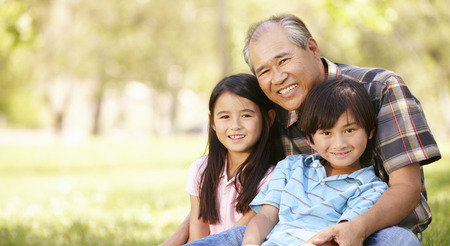 grandfather and grandson: Portrait Asian grandfather and grandchildren in park Stock Photo