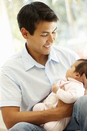 baby sitting: Asian father and baby Stock Photo