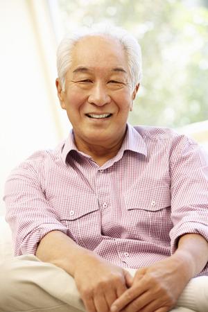 Senior Asian man at home Reklamní fotografie