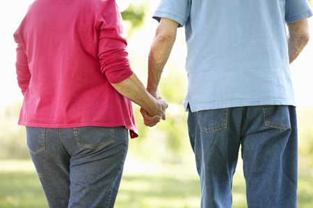 happily: Senior couple in park Stock Photo