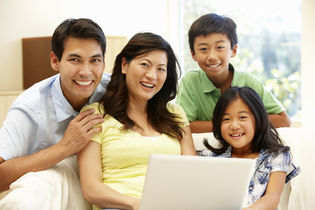 Asian family with laptop