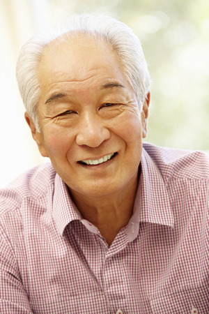 Senior Asian man at home Foto de archivo
