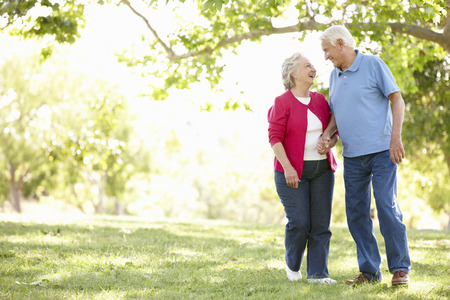 loving hands: Senior couple in park Stock Photo