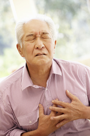 pain: Senior Asian man with chest pain Stock Photo