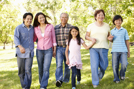 Multi-generation Asian family walking in park Stock Photo - 42108971