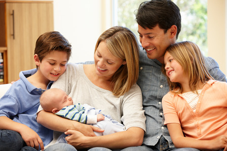 parents with baby: Family at home with new baby Stock Photo