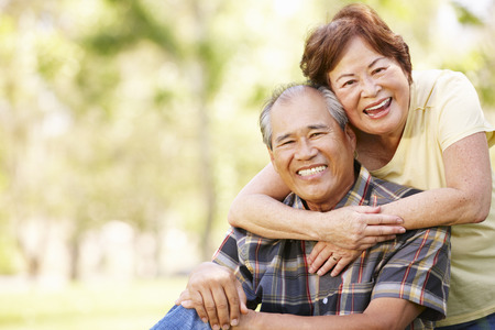 Portrait senior Asian couple in park Stock Photo