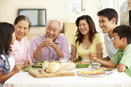 family indoors: Asian family sharing meal at home Stock Photo