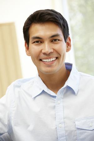 Asian man at home