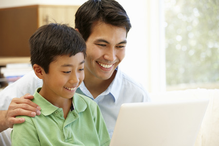 homework: Father and son using laptop