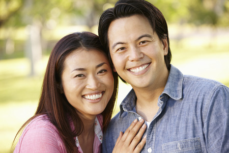 asian adult: Asian couple head and shoulders portrait outdoors