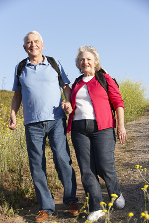 70s adult: Senior couple on country walk Stock Photo