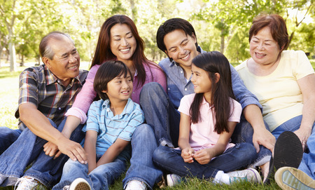 6 7 year old: Portrait multi-generation Asian family in park