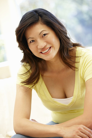 asian adult: Asian woman at home