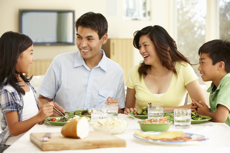 happy asian people: Asian family sharing meal at home Stock Photo