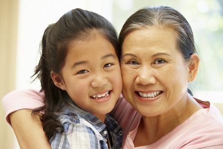 granddaughter: Senior Asian woman and granddaughter Stock Photo