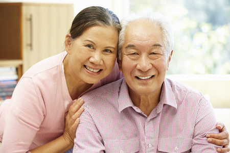 couple on couch: Senior Asian couple at home Stock Photo