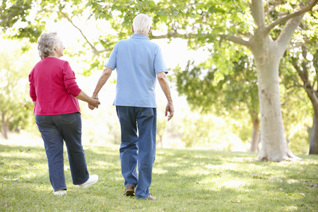 elderly adults: Senior couple in park Stock Photo