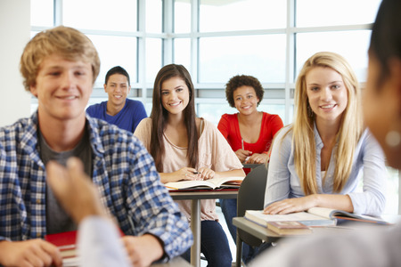 boy 15 year old: Multi racial teenage pupils in class Stock Photo