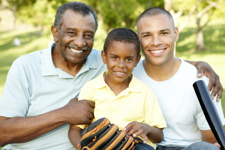 3 generation: African American Grandfather, Father And Son Playing Baseball In Park