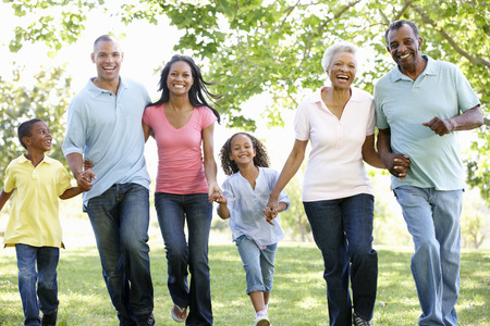 multi generation family: Multi Generation African American Family Walking In Park Stock Photo