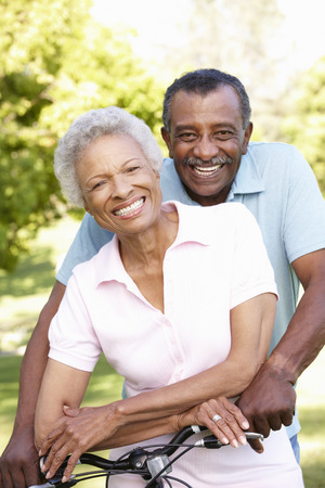 senior african: Senior African American Couple Cycling In Park