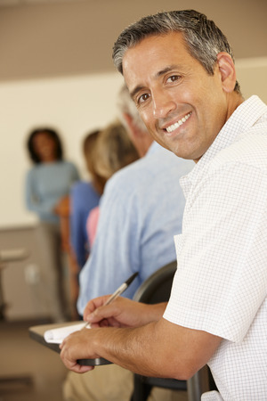 adult student: Mature student in class Stock Photo